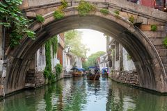Old stone arch bridge over a canal in the watertown Tongli, China stock photos