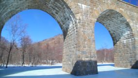 Old stone arch bridge stock footage