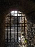 Old stone arch with iron grid gate. Belgrade fortress, Serbia royalty free stock image