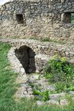 Old stone arched door of ruined ancient castle at Cisnadioara fortress in Sibiu,  Romania. Stone wall fortress with stairs leading