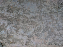 Old stone background texture. Grey rock scratched with marks, re Royalty Free Stock Image