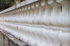 Old stone balustrade. In perspective. Soft selective focus and shallow depth of field Royalty Free Stock Photo