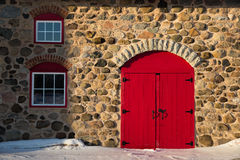 Old Stone Barn with Bright Red Door Royalty Free Stock Images