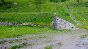 Old stone barn covered in grass Royalty Free Stock Photos