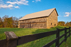 Old Stone Barn and Fence Royalty Free Stock Photography