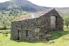 Old stone barn in landscape. Close up of Old stone barn in landscape Stock Images