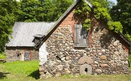 Old stone barns. In the park Jaunpils castle, Latvia stock image