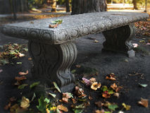 Old stone bench. An old Stone bench sitting on a college campus in the fall season royalty free stock photo