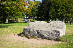 An old stone bench. On a sunny day stock photos