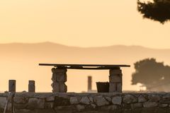 Old stone bench during sunset in Cres. Croatia Stock Image