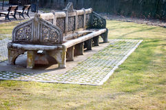 Old stone bench. Old traditional stone bench in bucharest Royalty Free Stock Photo