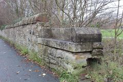 Stone Bench by the Canal. Old stone bench by the Union Canal in Edinburgh stock photo