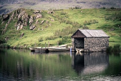 Boathouse. An old stone boathouse on a lake in Snowdonia, North Wales. Nostalgic effect with intentional vignetting Stock Photos