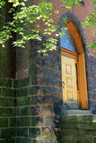 Old stone and brick building with wood door Royalty Free Stock Photography