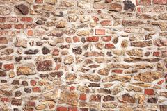 Old stone and brick medieval wall Stock Image