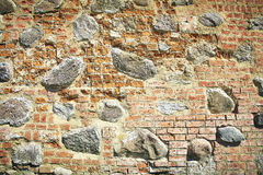 Old stone and brick wall of castle. Brick texture background Stock Photo