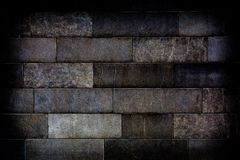 Old stone brick wall with dark vignette borders