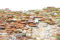 Old stone and brick wall with degraded plaster. On white background stock photos