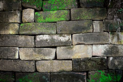Old stone brick wall with moss Royalty Free Stock Images