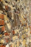 Old stone and brick wall in perspective stock images