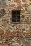 Old stone and brick wall with window Royalty Free Stock Photography