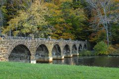 Old Stone Bridge. This is a picture of a old stone bridge in a park in Maryland, USA, set against a fall season background Royalty Free Stock Photo