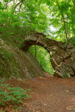 Old stone bridge. In the woods Royalty Free Stock Photo