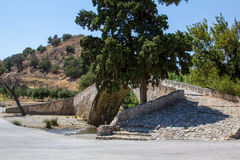 The old stone bridge across the river there in Crete. Royalty Free Stock Photography
