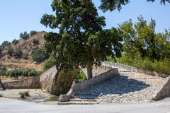 The old stone bridge across the river there in Crete. Royalty Free Stock Images
