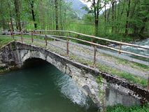 The old stone bridge across the Thur River in Unterwasser. Canton of St. Gallen, Switzerland stock image