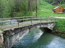 The old stone bridge across the Thur River in Unterwasser. Canton of St. Gallen, Switzerland royalty free stock photography