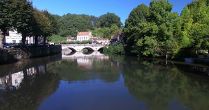 Old stone bridge in Brantome. Aerial view of old stone bridge in Brantome in Dordogne, France stock video footage