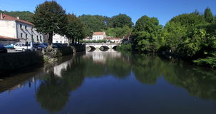 Old stone bridge in Brantome. Tracking shot of old stone bridge in Brantome in Dordogne, France stock footage