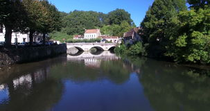 Old stone bridge in Brantome. Tracking shot of old stone bridge in Brantome in Dordogne, France stock video footage