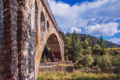 Old stone bridge. In the forest, Ukraine, Vorohta royalty free stock photos