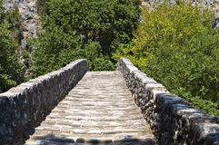 Old stone bridge in Greece Stock Photo