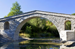 Old stone bridge at Greece Stock Photo