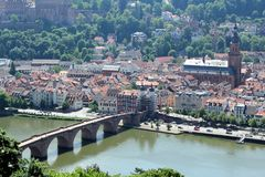 Old stone bridge in Heidelberg, Germany. Beautiful Heidelberg, Germany. View of old stone bridge. A medieval bridge gate is on the side of the old town, and was royalty free stock photos