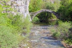 Old stone bridge of Kontodimos (built 1753 AD), Epirus, Greece. An arched bridge between Koukouli and Kipoi Stock Image