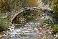 Old stone bridge in mountains Royalty Free Stock Photo