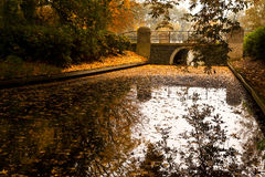 Old stone bridge over canal Stock Photography
