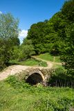 Old Stone bridge over Fotinovo River near village of Fotinovo in Rhodopes Mountain, Bulgaria. Old Stone bridge over Fotinovo River near village of Fotinovo in royalty free stock photo