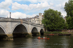 An old stone bridge over the river in Richmond. An old beautiful stone bridge over the river in Richmond Stock Images