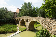 Old stone bridge over  river  in Vic Stock Photos