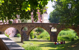 Old stone bridge over  river  in Vic. Catalonia Royalty Free Stock Photography