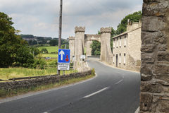 Old stone bridge set against new signage, North Yorkshire Royalty Free Stock Photo