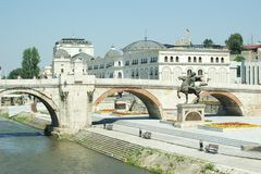 Old stone bridge in Skopje, together with Karposh statue. Taken from another bridge Stock Photo