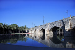 Old stone bridge on Spain. Bridge in lake on summer day Royalty Free Stock Images