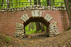 Old stone bridge in summer park Stock Image