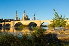 Old stone bridge in sunny morning. Zaragoza Stock Photo